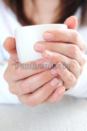 hands holding a cup