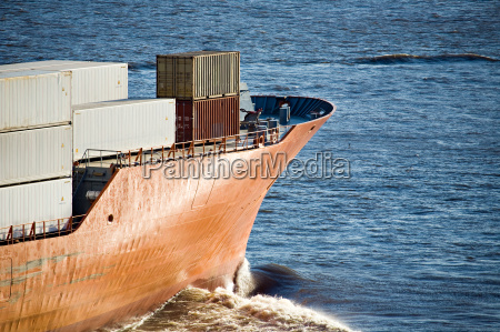 container ship heading out to sea