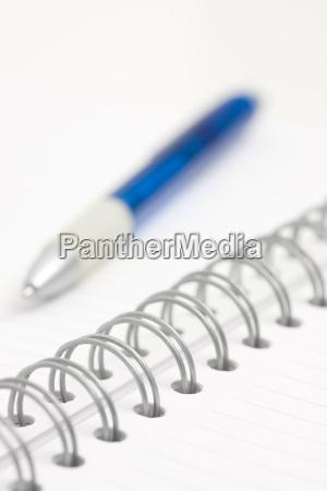 pen on spiral notebook