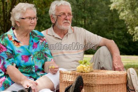 senior couple sitting in the park