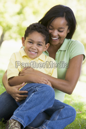 woman and young boy outdoors embracing