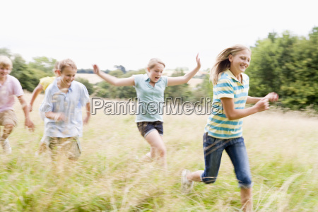 five young friends running in a