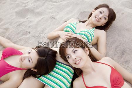 japanese weman lying on a beach