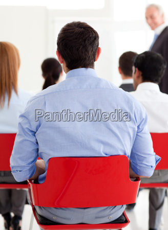 businessman from behind at a conference