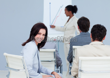 attractive businesswoman smiling at the camera
