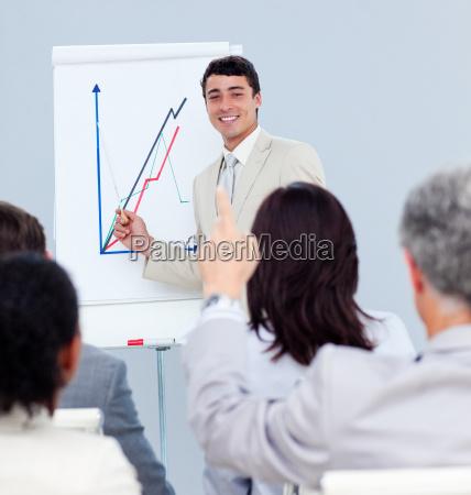 mature businessman asking a question at