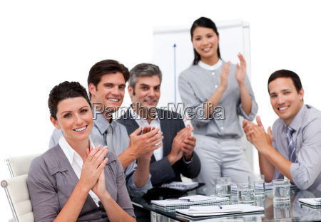 enthusiastic businessteam applauding after a presentation