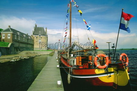 sailboat moored at a dock veere