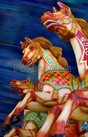 three horses of a carousel