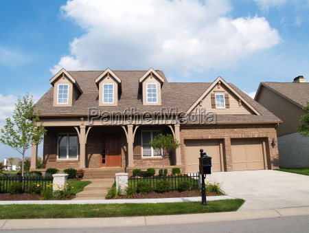 small two story brick home with