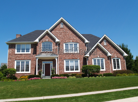 large two story brick residential home