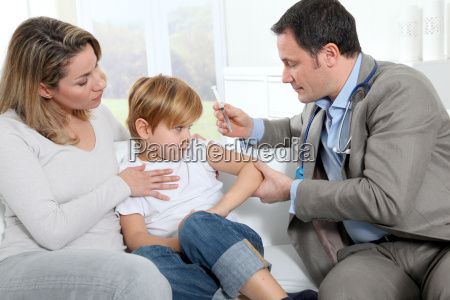 doctor doing vaccine injection to little