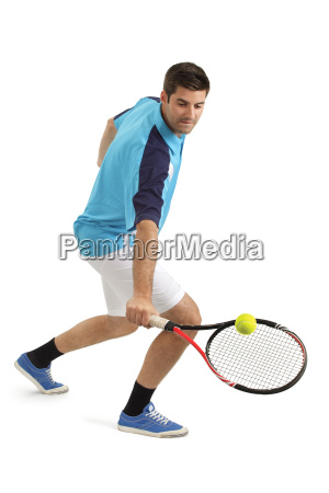male tennis player hitting the ball