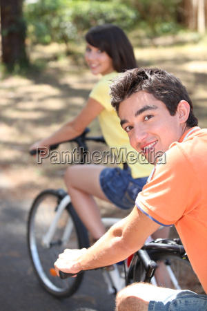 teenage boy and girl on bike