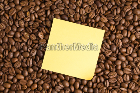 yellow note paper on coffee beans