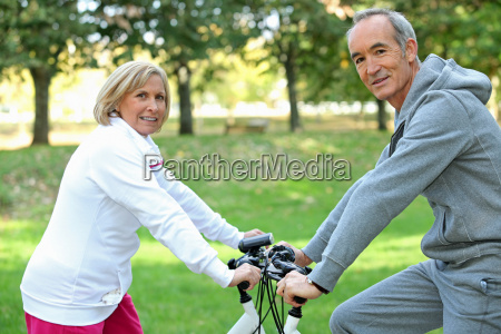 middle aged couple on bike ride