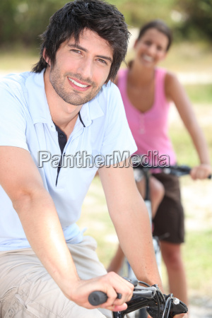 couple riding bicycle