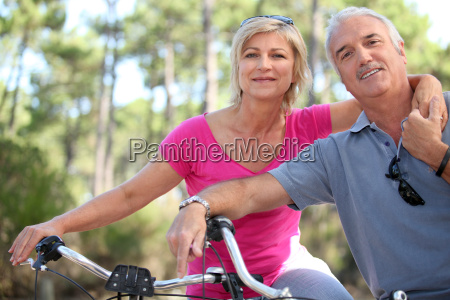 portrait of mature couple on bicycle