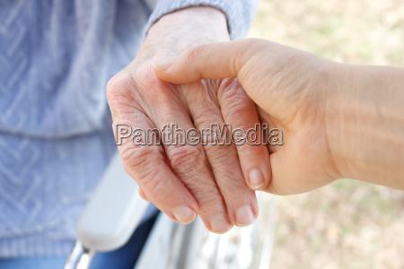 holding senior039s hand