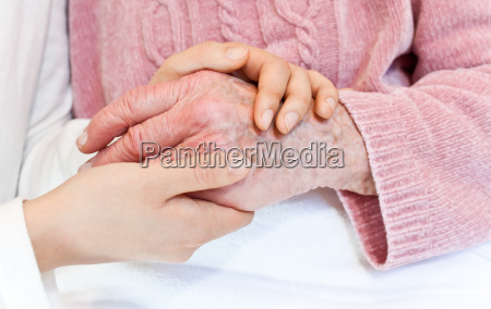 young holding senior039s hand