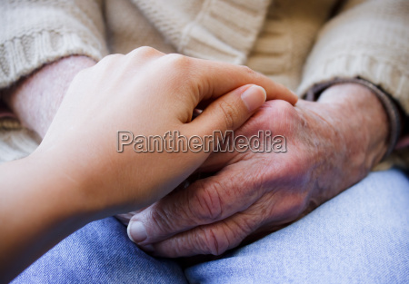 young holding senior039s hands