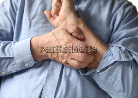 businessman with an itchy arm