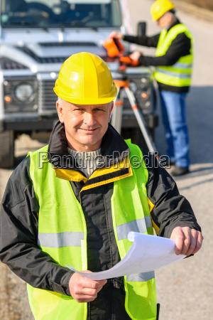land geodesist man hold plan reflective