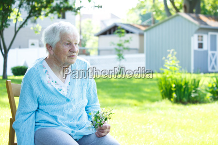 senior lady relaxing outside