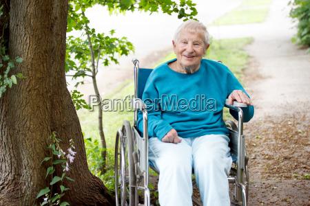 senior lady in wheelchair smiling