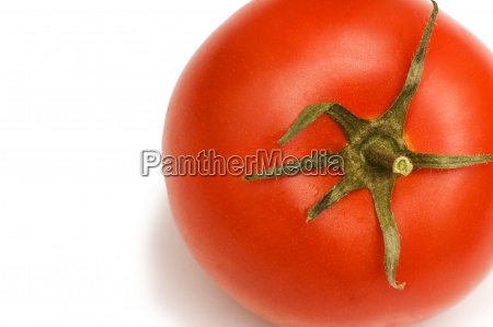 red tomato isolated on the white