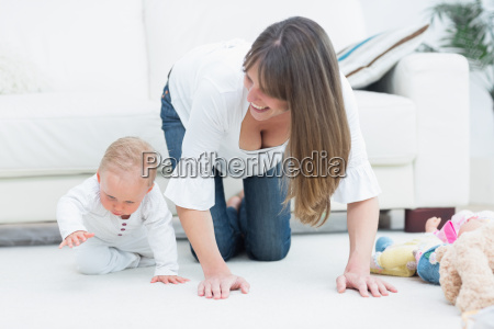 mother on all fours next to