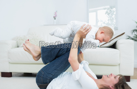 mother lying on back playing with