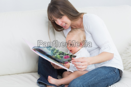 mother reading a book with a
