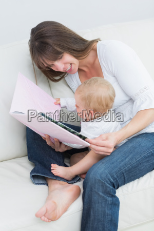 baby holding a book with a