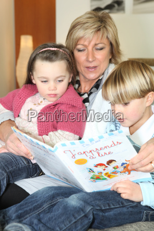 mother and two children reading together