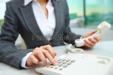 pressing telephone buttons