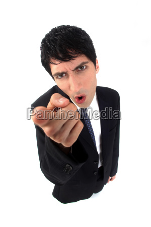 businessman shaking his finger in anger