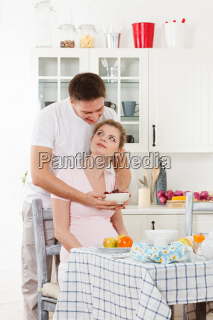 happy pregnant family and healthy food