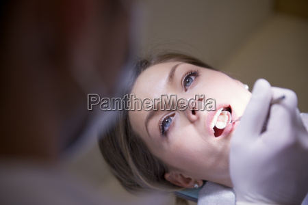 young woman in dental clinic with