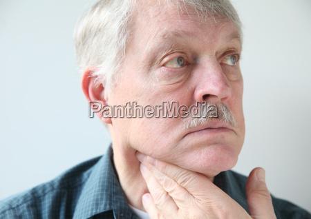 neck pain in senior man