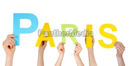hands holding paris