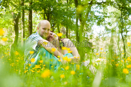 happy young couple is sitting in