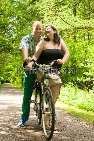 romnantic couple on a bike