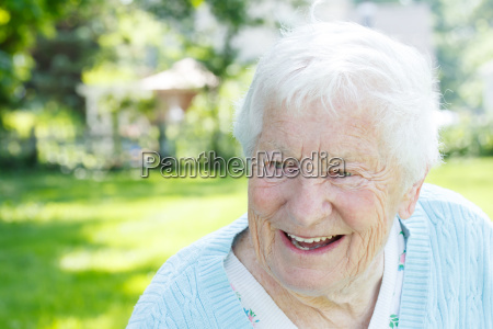senior woman in a blue sweater