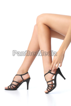woman with beautiful legs touching the