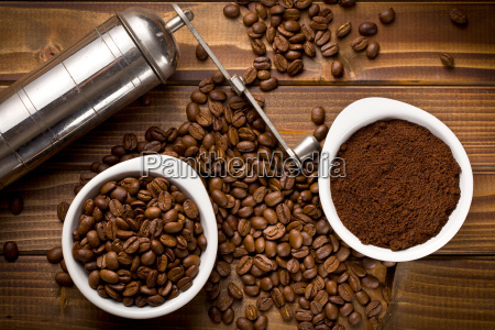 coffee beans with ground coffee and