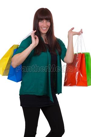 junge frau mit einkaufstaschen hat freude