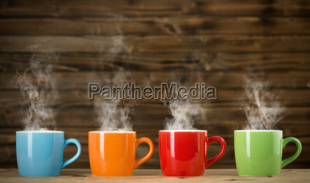 cups with steaming drink