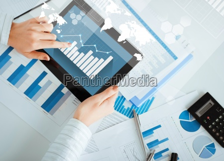 woman with tablet pc and chart