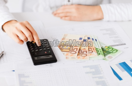 woman hand with calculator and euro